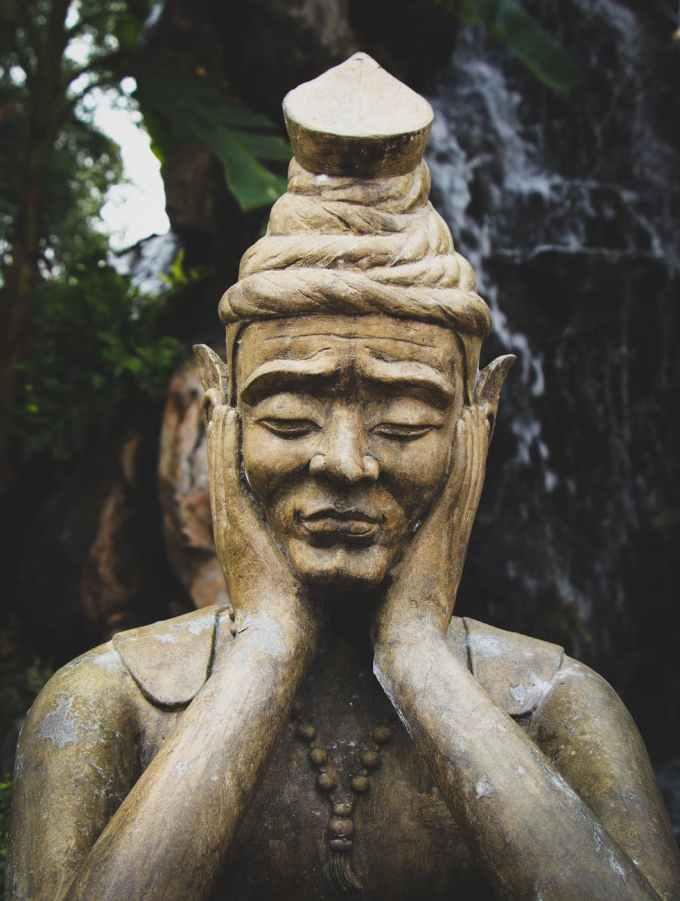selective focus photo of buddha statue